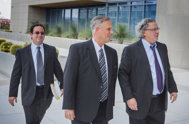Former Limousine company operator Charles Horky, center,  arrives for sentencing while walking with his attorneys Richard Shonfeld, left, and David Chesnoff at  Lloyd George Federal Courthouse, 33 ...