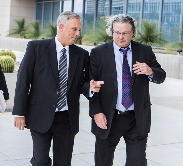 Former Limousine company operator Charles Horky,  left, arrives for sentencing while walking with his attorney  David Chesnoff  at  Lloyd George Federal Courthouse, 333 Las Vegas Boulevard South o ...