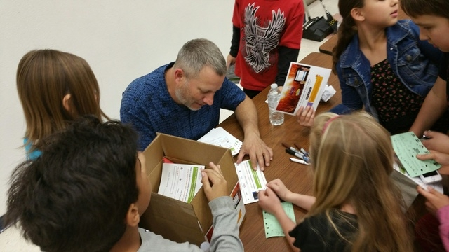Scott Flansburg signs autographs March 12, 2015, after giving a presentation on The Human Calculator at Ober Elementary School, 3035 Desert Marigold Lane. He represented Tabtor, which has a tablet ...