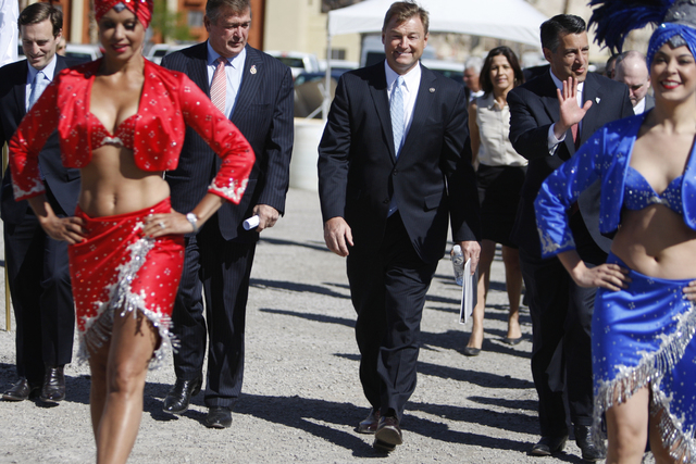 Nevada Attorney General Adam Laxalt, from left, U.S. Cresent Hardy, R-Nev., U.S. Sen. Dean Heller, R-Nev., and Nevada Gov. Brian Sandoval, make their way to their seats for the ground breaking cer ...