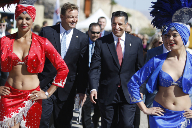 U.S. Sen. Dean Heller, R-Nev., left, and Nevada Gov. Brian Sandoval, make their way to their seats for the ground breaking ceremony for the I-11 Boulder City bypass project in Boulder City, Nev.,  ...