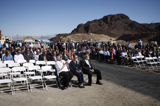Attendees listen during the ground breaking ceremony for the I-11 Boulder City bypass project in Boulder City, Nev., Monday, April 6, 2015. (Erik Verduzco/Las Vegas Review-Journal) Follow Erik Ver ...