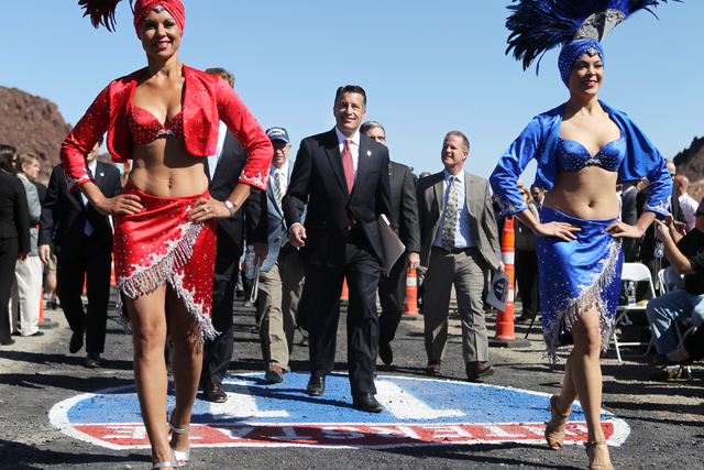 Nevada Gov. Brian Sandoval, center, makes his way to his seat for the ground breaking ceremony for the I-11 Boulder City bypass project in Boulder City, Nev., Monday, April 6, 2015. (Erik Verduzco ...