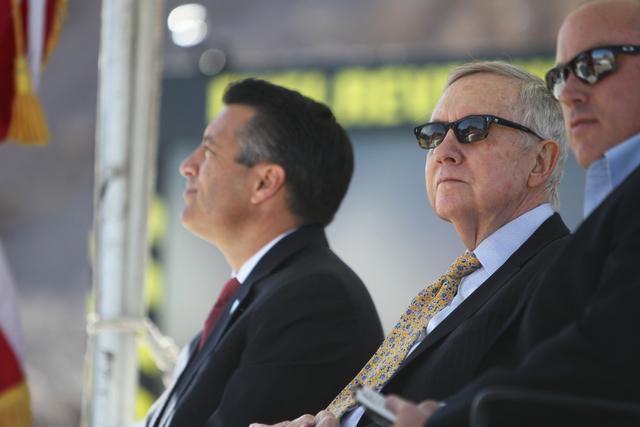 U.S. Sen. Harry Reid, D,Nev., center, with Nevada Gov. Brian Sandoval, left, and Boulder City Mayor Roger Tobler, listen during the ground breaking ceremony for the I-11 Boulder City bypass projec ...
