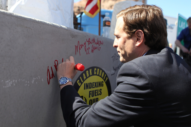 Nevada Attorney General Adam Laxalt signs a concrete box culvert during the ground breaking ceremony for the I-11 Boulder City bypass project in Boulder City, Nev., Monday, April 6, 2015. (Erik Ve ...