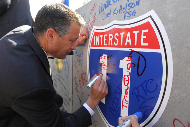 Nevada Gov. Brian Sandoval signs a concrete box culvert during the ground breaking ceremony for the I-11 Boulder City bypass project in Boulder City, Nev., Monday, April 6, 2015. (Erik Verduzco/La ...