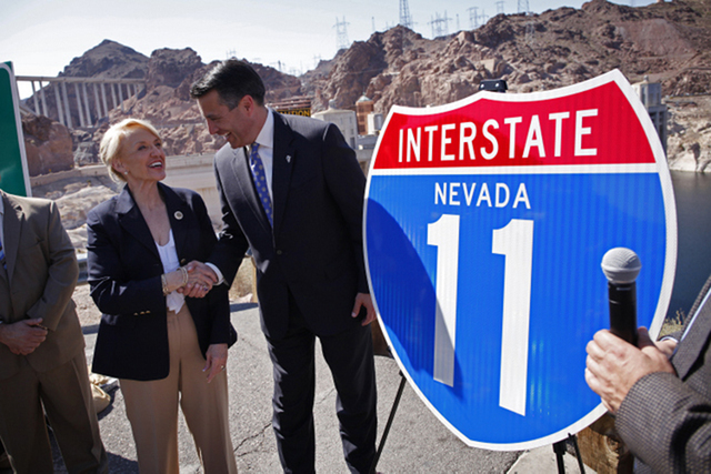 Nevada Governor Brian Sandoval, right, and Arizona Governor Jan Brewer shake hands on the Arizona side of Hoover Dam Friday, March 21, 2014 during an event to call attention to efforts to develop  ...