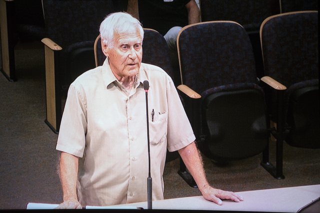 Henderson resident Jim Anderson, seen here on a monitor, expresses his opposition to the Blue Bell Ice Cream distribution center during a Henderson City Council session at City Hall on Tuesday, Ap ...