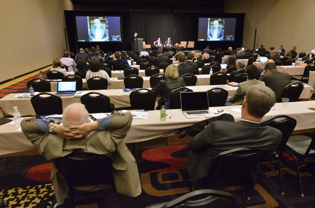 New Jersey Sen. Ray Lesniak is shown on the monitors during a Skype chat with attendees at the iGaming Business North America conference at the Planet Hollywood hotel-casino at 3667 Las Vegas Blvd ...