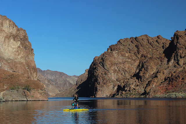 A pedaler on a hydrobike enjoys Black Canyon National Water Trail, located within Lake Mead National Recreation Area. The trail is one of only 16 national water trails in the United States, and th ...