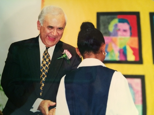Reynaldo Martinez, left, greets a student at Martinez Elementary School during a dedication ceremony in 2000. Martinez, a former political consultant, senior adviser and chief of staff for Sen. Ha ...