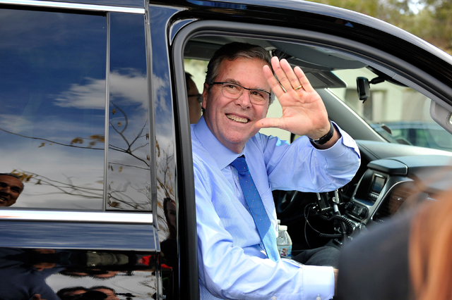 Former Florida Gov. Jeb Bush waves as he departs the Mountain Shadow Community Center in Sun City Summerlin after speaking in Las Vegas Monday, March 2, 2015. (David Becker/Las Vegas Review-Journal)