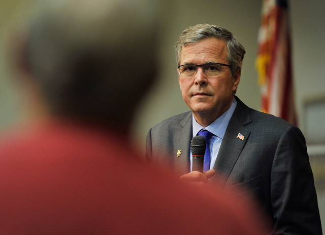 Former Florida Gov. Jeb Bush listens to a question from a supporter during a speaking engagement at the Mountain Shadow Community Center in Sun City Summerlin in Las Vegas Monday, March 2, 2015. ( ...