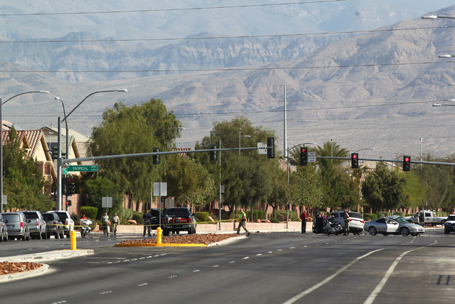 Las Vegas police investigate a fatal accident at Tropical Parkway and Jones Boulevard on Wednesday, April 22, 2015. (Chase Stevens/Las Vegas Review-Journal) Follow Chase Stevens on Twitter at @css ...