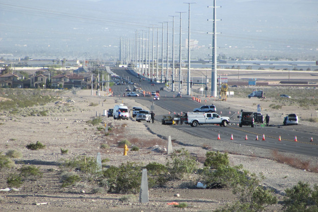 North Las Vegas police investigate a multivehicle crash on Lamb Boulevard, south of the 215 Beltway, that killed three people on Wednesday, April 15, 2015. A fourth person died on Thursday, April  ...