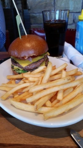 The All-American Burger at Lazy Dog has two charbroiled, quarter-pound beef patties layered with melted American cheese, topped with shredded lettuce, tomato, red onion, pickles and housemade Bark ...