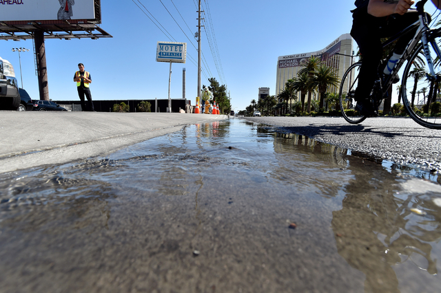 Water flows down the cutter from a fire hydrant to simulate a water leak along the Strip in Las Vegas on Monday, April 13, 2015.  The water district recently upgraded their permanent leak detectio ...