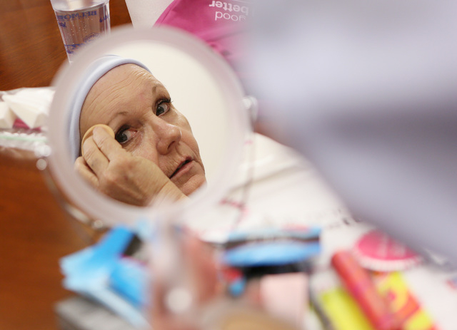 Christine Hernandez is reflected in a mirror as she puts on moisturizer during a Look Good Feel Better class at 21st Century Oncology March 24, 2015. (Ronda Churchill/View)