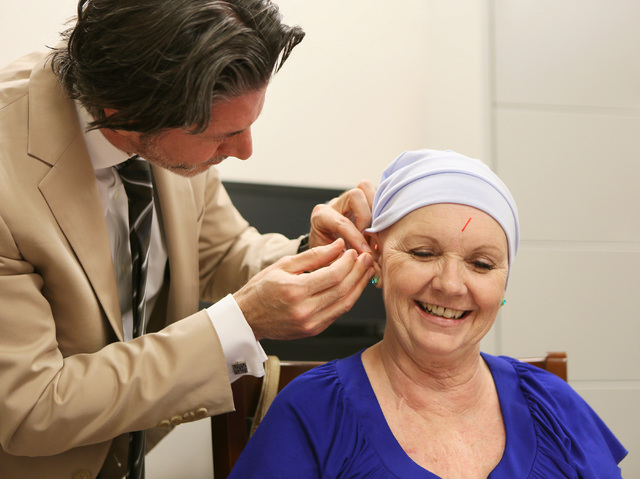 Dr. Brian Lawenda, left, an oncologist, performs acupuncture on Christine Hernandez during a Look Good Feel Better class at 21st Century Oncology March 24, 2015. (Ronda Churchill/View)