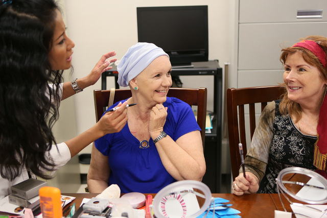 From left, Lia Yulianti, Christine Hernandez and Jan Lewellyn socialize during a Look Good Feel Better class at 21st Century Oncology March 24, 2015. (Ronda Churchill/View)