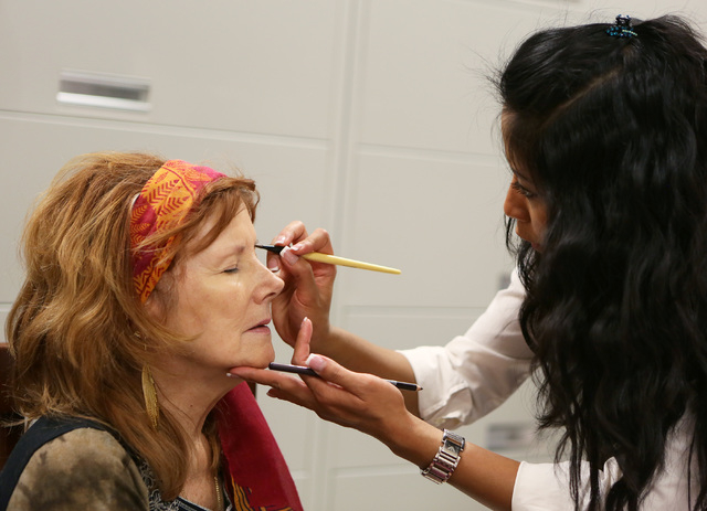 Jan Lewellyn, left, receives a makeup application from Lia Yulianti during a Look Good Feel Better class at 21st Century Oncology March 24, 2015. (Ronda Churchill/View)