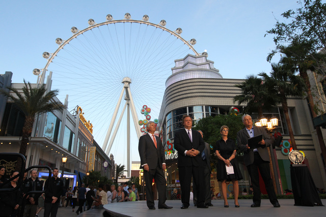 Clark County Commissioner Steve Sisolak, right, speaks during an event marking the one-year anniversary of the High Roller at The Linq Tuesday, March 31, 2015. Sisolak is joined by, from left, Cae ...