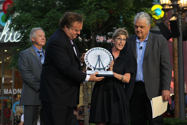 "Clark County Commissioner Chris Giunchigliani presents a ""Las Vegas Icon"" award to Caesars CEO Gary Loveman during an event marking the one-year anniversary of the High Roller at The Linq Tuesday, ..."