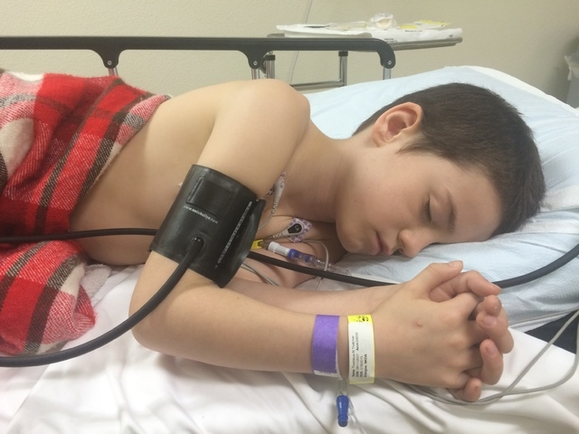 Thaddeus Thatcher, 7, sleeps as he receives chemotherapy at the Children's Specialty Center of Las Vegas, 3121 S. Maryland Parkway, No. 300, in this undated photo. Thaddeus was diagnosed with T- ...