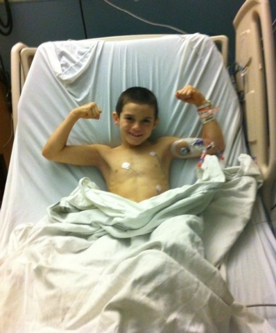 Thaddeus Thatcher, 7, shows off his muscles from gymnastics and football from his hospital bed at the Children's Specialty Center of Las Vegas in this undated photo. (Special to View)