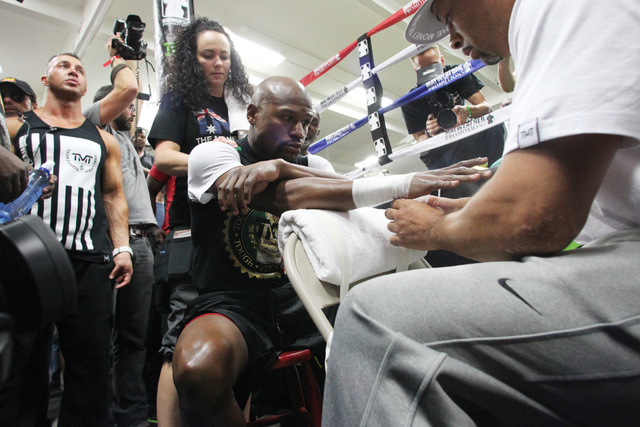 Floyd Mayweather gets his hands taped during his media workout Tuesday, April 14, 2015, in advance of his May 2nd fight against Manny Pacquiao. (Sam Morris/Las Vegas Review-Journal) Follow Sam Mor ...