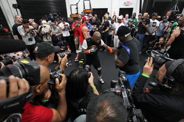 Floyd Mayweather hits a body pad during his media workout Tuesday, April 14, 2015, in advance of his May 2nd fight against Manny Pacquiao. (Sam Morris/Las Vegas Review-Journal) Follow Sam Morris o ...