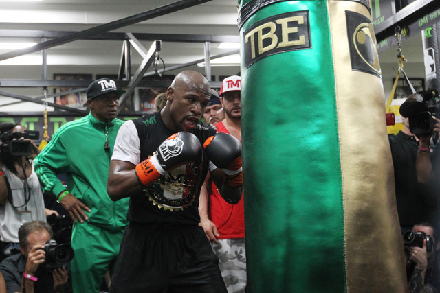 Floyd Mayweather hits a heavy bag during his media workout Tuesday, April 14, 2015, in advance of his May 2nd fight against Manny Pacquiao. (Sam Morris/Las Vegas Review-Journal) Follow Sam Morris  ...