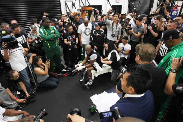Floyd Mayweather gets a massage during his media workout Tuesday, April 14, 2015, in advance of his May 2nd fight against Manny Pacquiao. (Sam Morris/Las Vegas Review-Journal) Follow Sam Morris on ...