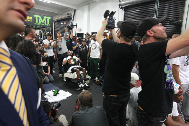 Floyd Mayweather does sit ups during his media workout Tuesday, April 14, 2015, in advance of his May 2nd fight against Manny Pacquiao. (Sam Morris/Las Vegas Review-Journal) Follow Sam Morris on T ...
