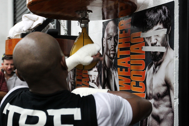 The eyes of Manny Pacquiao are taped over on a poster as Floyd Mayweather hits a speed bag during his media workout Tuesday, April 14, 2015, in advance of his May 2nd fight against Manny Pacquiao. ...