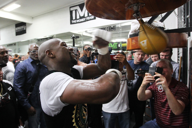 Floyd Mayweather hits a speed bag during his media workout Tuesday, April 14, 2015, in advance of his May 2nd fight against Manny Pacquiao. (Sam Morris/Las Vegas Review-Journal) Follow Sam Morris  ...