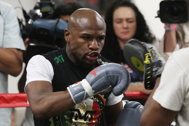 Floyd Mayweather hits pads during his media workout Tuesday, April 14, 2015, in advance of his May 2nd fight against Manny Pacquiao. (Sam Morris/Las Vegas Review-Journal) Follow Sam Morris on Twit ...