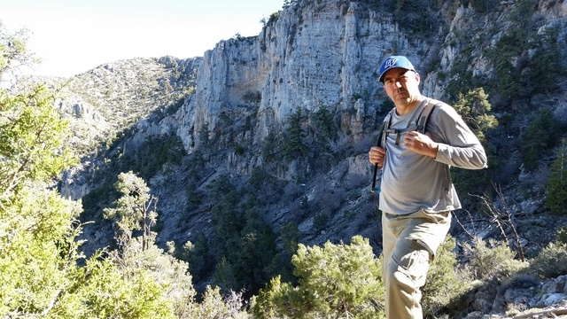 Las Vegas Review-Journal sports columnist Ron Kantowski stands near the cliffs atop Mount Potosi southwest of Las Vegas where actress Carole Lombard and 21 others were killed in a plane crash on J ...