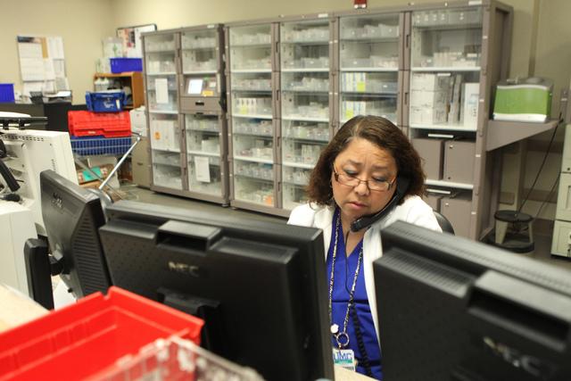 Pharmacist Annabelle Paez takes a call inside the University Medical Center pharmacy in Las Vegas Wednesday, April 8, 2015. (Erik Verduzco/Las Vegas Review-Journal) Follow Erik Verduzco on Twitter ...