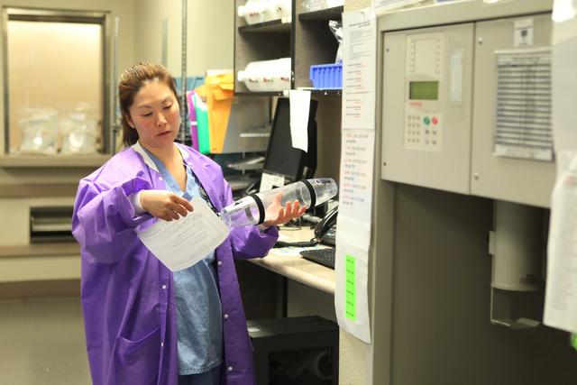 Pharmacy technician Young Rhee fills reads a prescription  label inside the University Medical Center pharmacy in Las Vegas Wednesday, April 8, 2015. (Erik Verduzco/Las Vegas Review-Journal) Follo ...