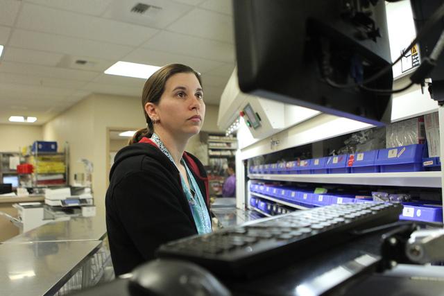 Senior pharmacy technician Shauna Henderson reads a prescription on her computer inside the University Medical Center pharmacy in Las Vegas Wednesday, April 8, 2015. (Erik Verduzco/Las Vegas Revie ...