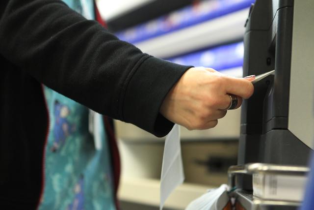 Senior pharmacy technician Shauna Henderson grabs a prescription label from a printer inside the University Medical Center pharmacy in Las Vegas Wednesday, April 8, 2015. (Erik Verduzco/Las Vegas  ...