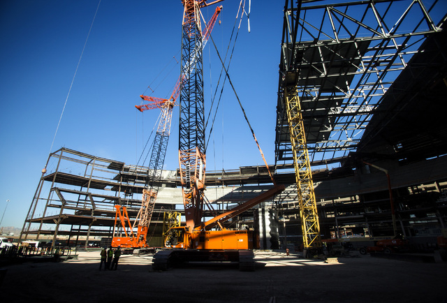 Construction at the MGM Resorts International-AEG arena behind New York-New York casino-hotel is seen Monday, March 30, 2015. The $375 million arena is scheduled to open in April 2016. (Jeff Schei ...