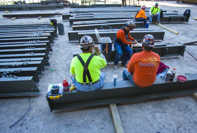 Workers take a break at MGM Resorts International-AEG arena construction site behind New York-New York casino-hotel Monday, March 30, 2015. The $375 million arena is scheduled to open in April 201 ...