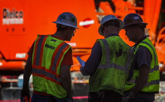 Workers talk while at MGM Resorts International-AEG arena construction site behind New York-New York casino-hotel Monday, March 30, 2015. The $375 million arena is scheduled to open in April 2016. ...