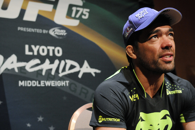 Mixed martial artist Lyoto Machida is interviewed during media day at Mandalay Bay Events Center in Las Vegas Thursday, July 3, 2014. Machida is slated to face middleweight champion Chris Weidman  ...