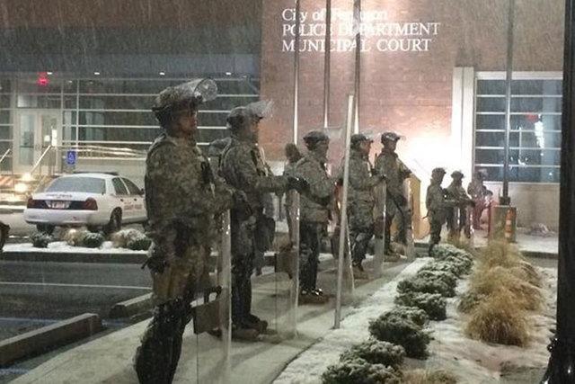 Snow falls on the Missouri National Guard standing outside of Ferguson Police Department on Nov. 26. (Sara Sidner/CNN)