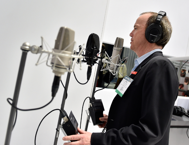 Sales representative Daniel Huard with Sennheiser tests microphones at his company's booth during the National Association of Broadcasters show at the Las Vegas Convention Center on Tuesday, April ...