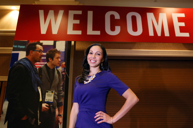 Chekesha Van Putten, owner of Trade Show Casting, stands near Exhibitor Live trade show signage at Mandalay Bay convention center Thursday, March 5, 2015, in Las Vegas. Trade Show Casting is a com ...