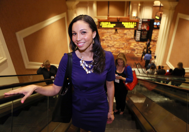 Chekesha Van Putten, owner of Trade Show Casting, stands on an escalator at Mandalay Bay convention center Thursday, March 5, 2015, in Las Vegas. Trade Show Casting is a company that casts models, ...